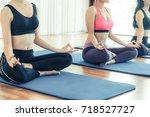 women practicing yoga pose in...   Shutterstock . vector #718527727