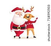 santa claus with deer.... | Shutterstock .eps vector #718592503