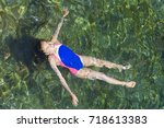 floating on her back at sea ...   Shutterstock . vector #718613383