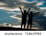 silhoutte of two brothers... | Shutterstock . vector #718619983