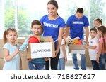 happy volunteers with children... | Shutterstock . vector #718627627