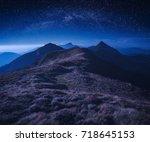 starry night sky above the... | Shutterstock . vector #718645153