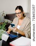 female entrepreneur working... | Shutterstock . vector #718651357