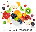 fresh mixed fruits falling on... | Shutterstock . vector #718681507