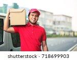 parcel delivery man smiling... | Shutterstock . vector #718699903