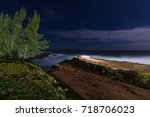 Small photo of Blue dark night sky with many stars above the sea coastline. Ponta Negra, Marica - Rio de Janeiro Brazil