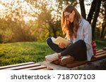 side view of pleased brunette... | Shutterstock . vector #718707103
