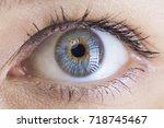 blue eye of a beautiful woman | Shutterstock . vector #718745467