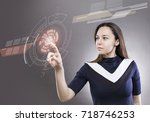 young woman touching the... | Shutterstock . vector #718746253