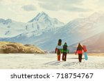 group of three snowboarders... | Shutterstock . vector #718754767