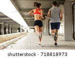 couple of  runners jogging on... | Shutterstock . vector #718818973