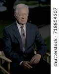 Small photo of Washington. DC. USA, 13th September, 1993 Former President James (Jimmy) Carter sits for a TV interview on the North Lawn of the White House prior to attending the annual Presidents dinner