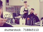 young american male hairdresser ... | Shutterstock . vector #718865113