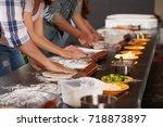 hands of people making pizzas...   Shutterstock . vector #718873897