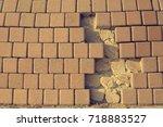 the wall with the fallen bricks | Shutterstock . vector #718883527
