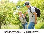 senior couple hiking    Shutterstock . vector #718885993