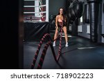 woman with battle ropes... | Shutterstock . vector #718902223