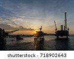 silhouette of bridge connected... | Shutterstock . vector #718902643