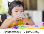 little girl playing with... | Shutterstock . vector #718928257