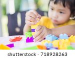 little girl playing with... | Shutterstock . vector #718928263