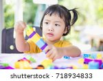 little girl playing with... | Shutterstock . vector #718934833