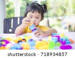 little girl playing with... | Shutterstock . vector #718934857