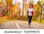 mature asian woman running... | Shutterstock . vector #718959673