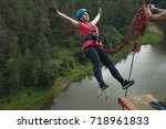 young woman jumps on a rope... | Shutterstock . vector #718961833