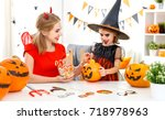 a happy family mother and child ... | Shutterstock . vector #718978963