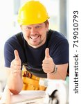 Small photo of Smiling worker in yellow helmet show confirm sign with thumb up at arm portrait. Manual job, DIY inspiration, joinery startup idea, fix shop, hard hat, industrial education, profession career concept