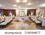decorated wedding table in the... | Shutterstock . vector #719034877