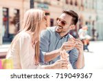 happy young couple.they are... | Shutterstock . vector #719049367
