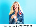 happy young woman holding union ... | Shutterstock . vector #719072527
