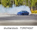 Small photo of Race car drifting on speed track