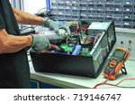 technicians are repairing... | Shutterstock . vector #719146747