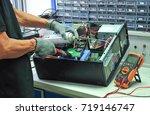 technicians are repairing... | Shutterstock . vector #719146747
