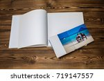open book with a photo couples... | Shutterstock . vector #719147557