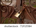 Locked Chain On Old Rusty Gate