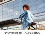 view from below of pleased... | Shutterstock . vector #719185807