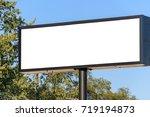 blank billboard with blue sky... | Shutterstock . vector #719194873
