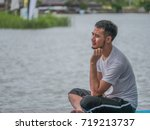 a young man take a relax at the ... | Shutterstock . vector #719213737
