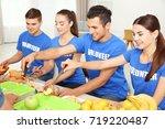 teen volunteers serving food... | Shutterstock . vector #719220487