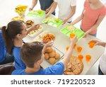 volunteers serving food for... | Shutterstock . vector #719220523