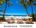 tropical vacation on white sand ... | Shutterstock . vector #719230693
