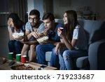 friends watching tv in evening... | Shutterstock . vector #719233687