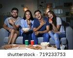friends watching tv in evening... | Shutterstock . vector #719233753
