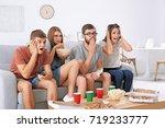 friends watching tv at home | Shutterstock . vector #719233777
