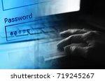man hand on a laptop keyboard.... | Shutterstock . vector #719245267