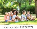 group of children sitting on... | Shutterstock . vector #719249077