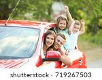 happy family in car | Shutterstock . vector #719267503